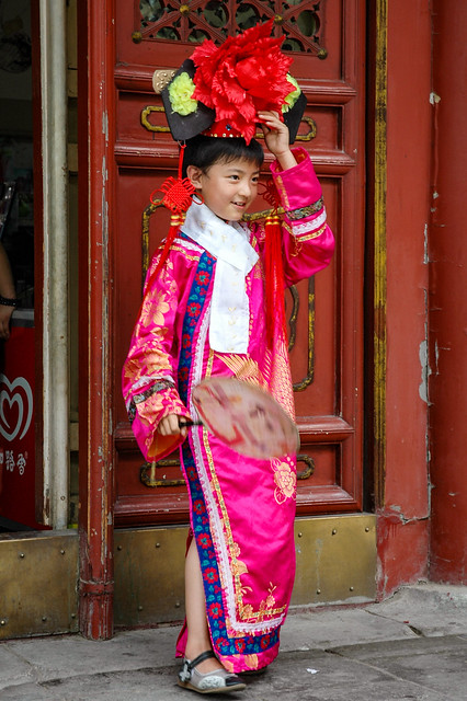 Little Chinese girl in traditional costume