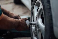 Tire technician changing a wheel