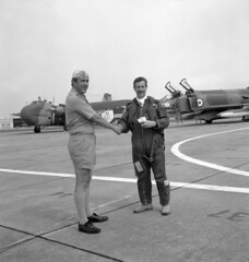 1972 41 Sqn RNZAF & 41 Sqn RAF meeting in Singapore. Pilots from each squadron exchanging plaques with their respective squadron Badges. In the background is No. 41 Sqn Bristol Freighter NZ5912 and a 41 Sqn F-4 Phantom.