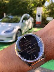 Smartwatch and Tesla Model 3