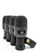 Set of Microphones for Drums isolated above white background