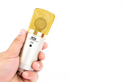 Condenser Studio Microphone in the hand with copy space