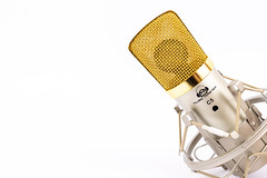 Condenser Studio Microphone with golden cap and copy space