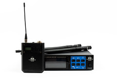 Wireless Receiver and Transmitter for Vocal Microphone above white background