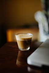 Closeup of nespreso on wooden table.