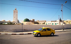 Tunisia, Houmt Souk - Taxi driving past a mosque - April 2010