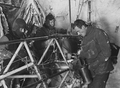Bickerton repairs the Air-tractor, Antarctica, 1912-1913, Frank Hurley