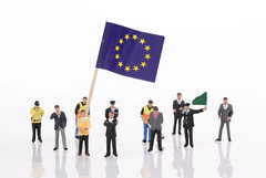 Miniature people with flag of European Union