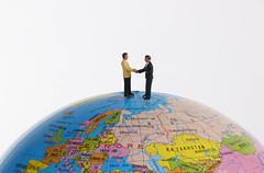 Miniature businessman on the globe