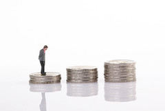 Businessman standing on step of coin money. Concept of Financial and money.