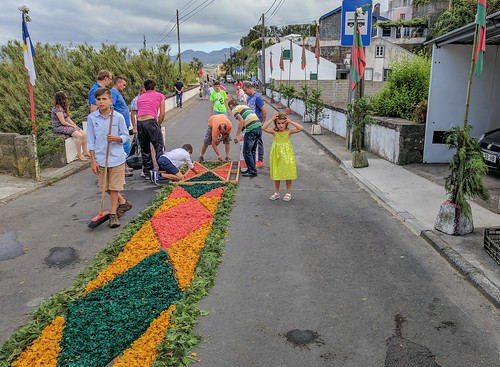 Families of the village of Santo Antonio decorate their street for the Patron Saint festival
