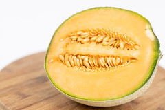 Sliced Melon with copy space above white background