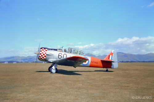 RNZAF Harvard NZ1060 with Red Checkers cowling, note what appears to be a large tank in the rear cockpit, date and location unknown, but probably Wigram