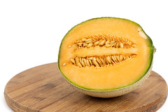 Sliced Melon on the round wooden board