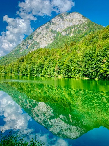 Lake Stimmersee with reflections and Pendling mountain in Tyrol, Austria