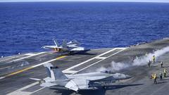An F/A-18F Super Hornet launches from the flight deck of USS Theodore Roosevelt (CVN 71).