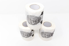 Three rolls of Donal Trump toilet paper with white background