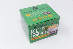 A green box of instant Keto coffee with MCT and collagen for a low-carb, high-fat ketogenic diet