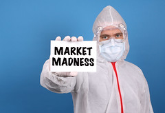 Medical doctor holding banner with Market Madness text, Isolated over blue background
