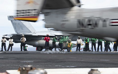 An E-2D Hawkeye launches from the flight deck of USS Ronald Reagan (CVN 76) during flight operations.