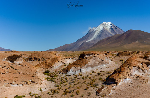 Crater of Tunupa Volcano near Uyuni, Bolivia. Amazing volcano landscape two days driving from Uyuni. With rock formations and steam coming from volcano. Selective focus.