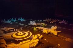 Sailors arrange aircraft on the flight deck aboard USS Dwight D. Eisenhower (CVN 69), June 16, 2020.