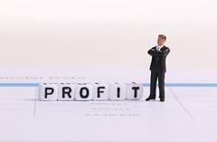 Businessman figure with Profit text
