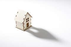 Small wooden house on white background