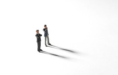 Two businessman standing on white background