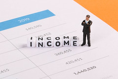 Businessman figure with Income text