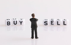 Businessman figure with Buy and Sell text