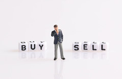 Businessman figure standing in front of Buy and Sell text