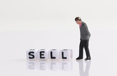 Businessman figure with Sell text