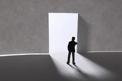 Man standing in front of mysterious open door