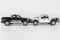 Black police and white metal Pickup car models