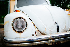 Front view of rusty and deserted volkswagen car