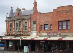 Geelong. On the corner of Malop and Yarra streets. The former Corio lawyers Chambers. Built in the 1890s in Queen Anne style. Corner spire pediment in the roof line, elaborate window decoration.