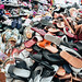 Bangkok, Thailand - November 28, 2019: Piles of shoes and sandals at a store Inside the MBK Center Mall, known for cheap shopping and knock off designer goods