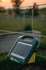 Close-up focused picture of solar energiser for the electric fence on the farm