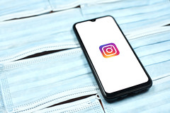 Instagram application on smartphone. Spending time at quarantine