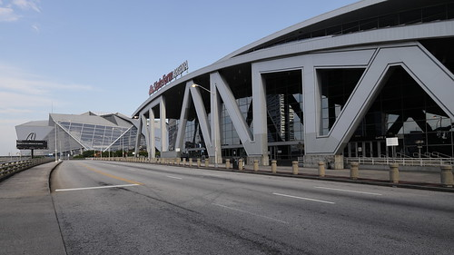 State Farm Arena (formerly Phillips Arena) in the foreground and Mercedes-Benz Stadium