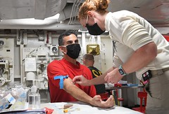 Capt. Carlos Sardiello speaks to the nurse, before giving blood to test for COVID-19 antibodies.