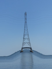 Electrical Transmission Tower on a Wave