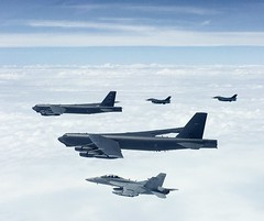 A U.S. Navy  EA-18G Growler and F-2s from the Japan Air Self-Defense Force fly together off the wing of two U.S. Air Force B-52H Stratofortresses.