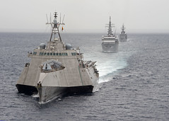 USS Gabrielle Giffords (LCS 10), left, exercises with the Japan Maritime Self-Defense Force.