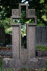 Art Deco cut out open cross headstone City of London Cemetery darker warmer