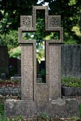 Art Deco cut out open cross headstone City of London Cemetery darker cooler