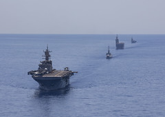 USS Bataan (LHD 5), left, leads French and Italian navy ships during a maritime training exercise.
