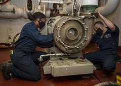 Sailors perform corrective maintenance on a water pump aboard USS Carl Vinson (CVN 70).