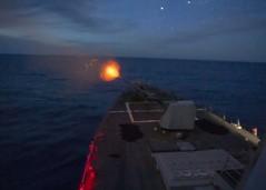 USS Mustin (DDG 89) fires its Mark 45 5-inch gun.
